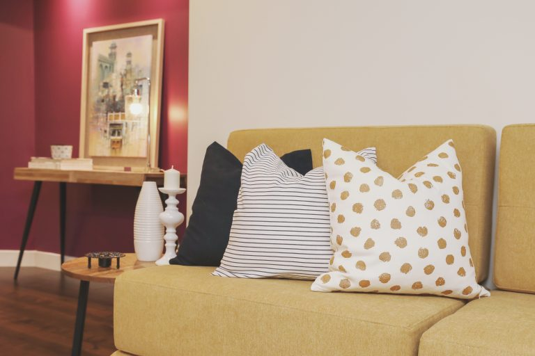 basement decor, yellow and purple custom seating, accent wall colour in Plum